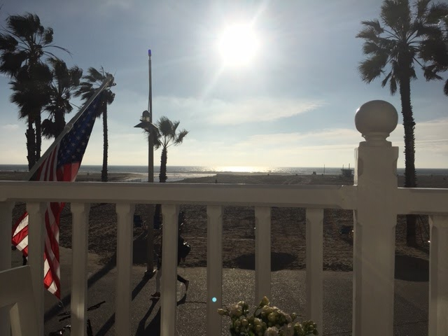 View of beach with American flag